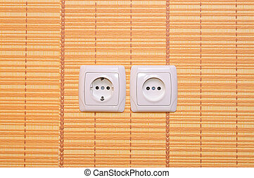 Light switch on the wall - Electrical outlet in the wall