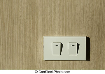Light switch on wall.