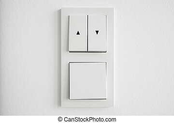 light switch, up down switch closeup on white wall