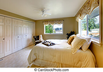 Light tones bedroom with a queen size bed