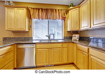 Light tones kitchen interior with modern wooden cabinets.
