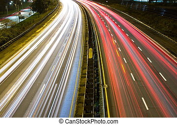 Light trail on a busy motorway high angle