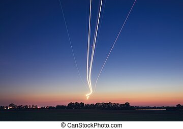 Light trails of airplane during landing
