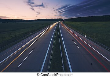 Light trails of cars on highway