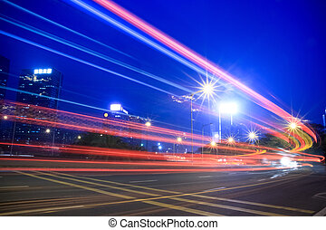 light trails of highway - light trails on the highway at...
