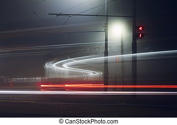 Light trails of trams at station