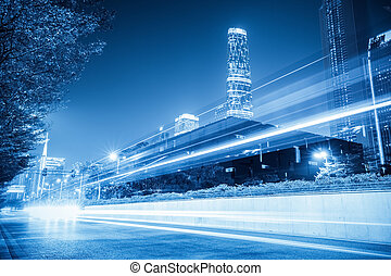 light trails on city with blue tone