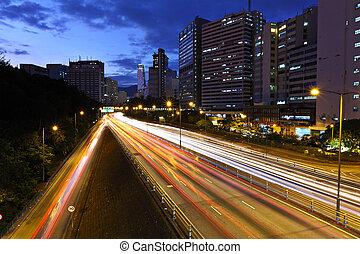 light trails on modern city at night