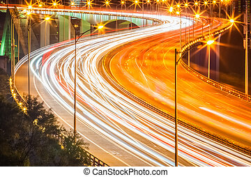 light trails on the bridge at night
