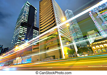 light trails on the modern building background in Hong Kong