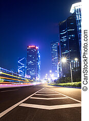 light trails on the ramp with building background