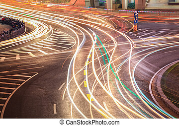 light trails on the roundabout road