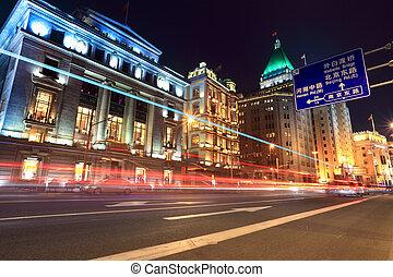 light trails on the street in shanghai bund - light trails...