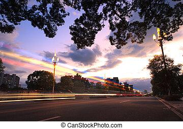 Light trails on the urban street at twilight