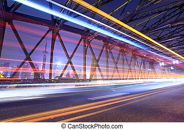 light trails through the garden bridge in shanghai
