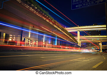 light trails with highway viaduct