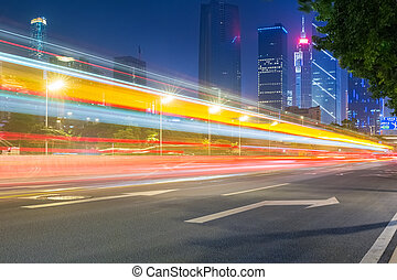 light trails  with modern building