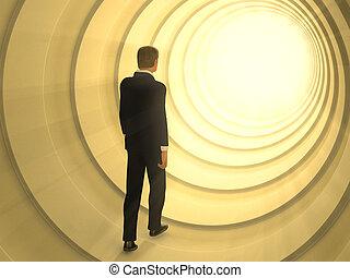 Light tunnel - Man walking in a tunnel toward a bright light...