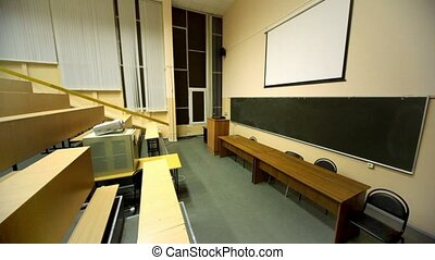 Light turned off, and then switched on, in empty lecture...