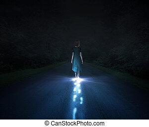 Light walking - A woman walking at night and leaving bright...