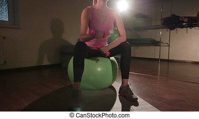 Light weight training on stability ball in health fitness club
