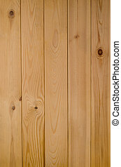 Photograph of a panel of light wood tongue and groove planking, shot vertically.