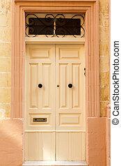 Light  wooden front door to the house
