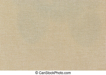light yellow knitted fabric texture or background.