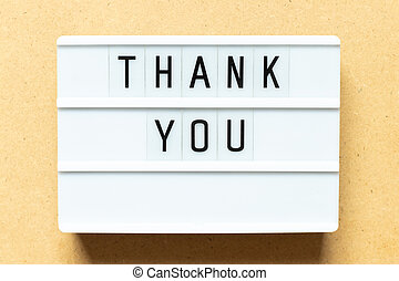 Lightbox with word thank you on wood background