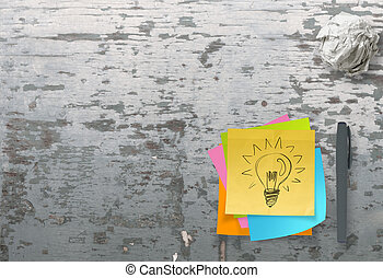 lightbulb as creative on crumpled sticky note paper on...