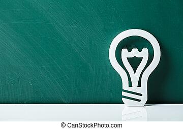 Lightbulb Leaning On Chalkboard
