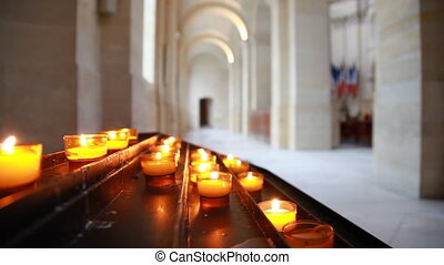 Lighted candles in glass cups on table - lighted candles in...