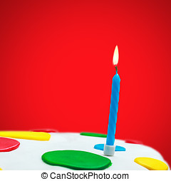 Lighted candles on a birthday cake