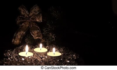 Lighted candles on a christmas back