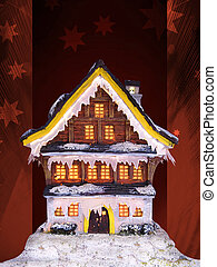 christmas house - lighted christmas house in a dark holy...