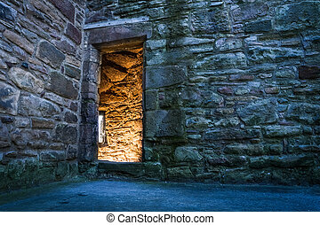 Lighted dorway to the medieval castle