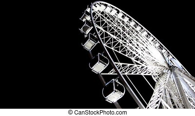 Lighted Ferris wheel at Champs Elysees - PARIS - DECEMBER...