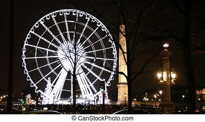 Lighted Ferris wheel, Luxor obelisk and road at Champs Elysees