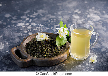 Lightening tonic green tea in a glass cup.
