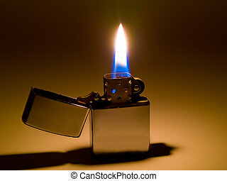 A cigarette lighter with a yellow and blue flame.