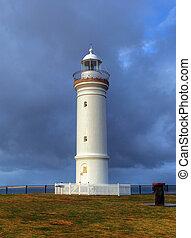 lighthouse against dramatic sky