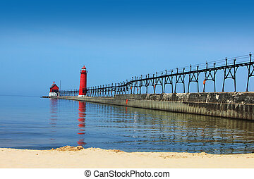 Lighthouse and Pier Grand Heaven Michigan in the summer time