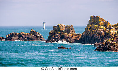 Lighthouse and rocks on the sea