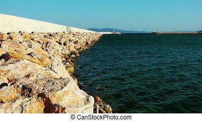 Lighthouse and Sea