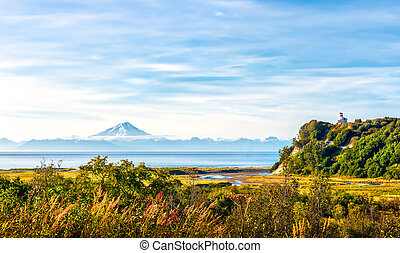 Lighthouse and Volcano on the Cook Inlet in Alaska
