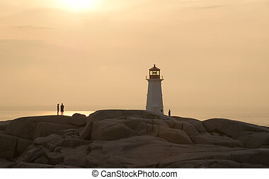 An east coast lighthouse in sillouette at sunset.