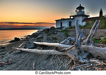 Lighthouse at dusk - West Point lighthouse at Discovery park...