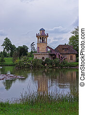 Lighthouse at lake in Old village of Marie Antoinette Versailles