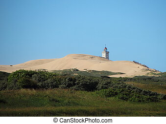 Lighthouse at Rubjerg Knude with Sand dune and Blue Sky