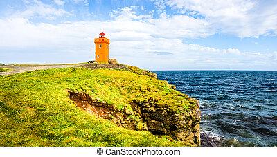 Lighthouse at seashore of Iceland